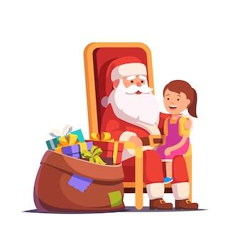 Santa claus hält kleine lächelnde mädchen auf seinem schoß