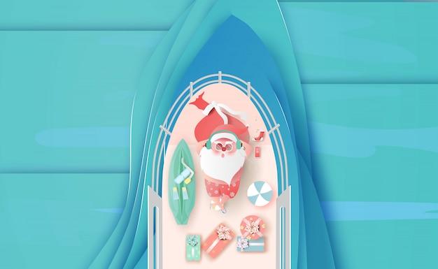 Santa claus nimmt in einem schiff ein sonnenbad
