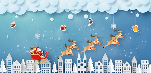 Santa claus- und renfliegen auf dem himmel mit hängenden geschenken