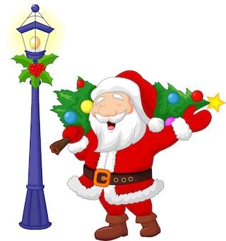 Santa trägt einen weihnachtsbaum