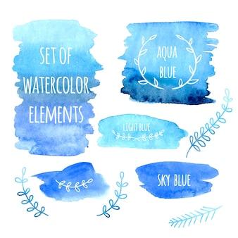 Satz aquarellflecken und blumengestaltungselemente