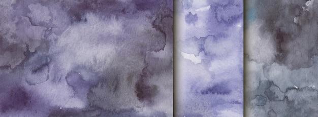 Satz aquarelltexturen, hintergrund mit streifen und flecken, schwarze farbe Premium Vektoren