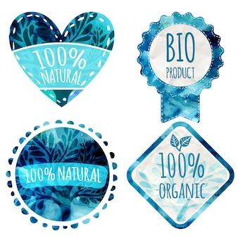 Satz blaue vektor-öko-abzeichen mit papierstruktur und blättern