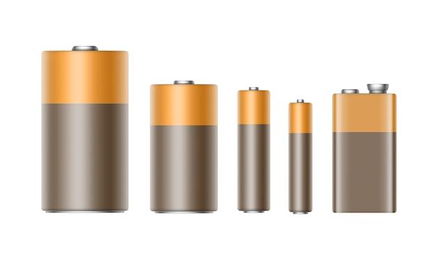 Satz braun-gelb-goldene glänzende alkalibatterien unterschiedlicher größe aaa-, aa-, c-, d-, pp3- und 9-volt-batterie für das branding nahaufnahme isoliert auf weißem hintergrund