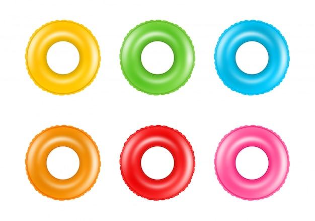 Satz bunte schwimmringe. sammlung von aufblasbaren gummiringen. schwimmendes sommerspielzeug.