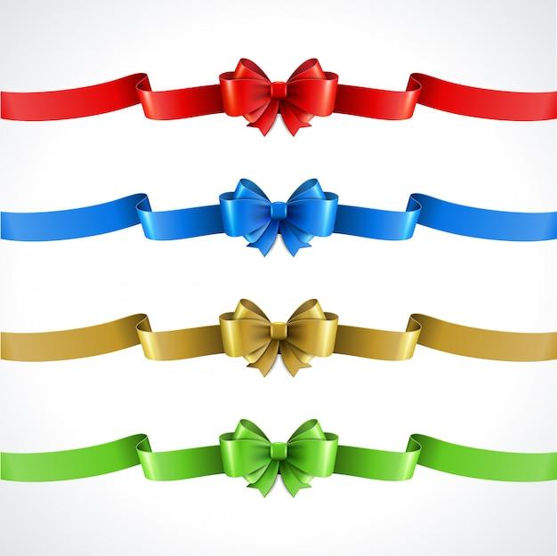 Satz dekoratives geschenk beugt mit den bändern, die auf weiß lokalisiert werden