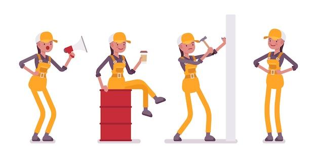 Satz der arbeitnehmerin im gelben overall mit werkzeugen