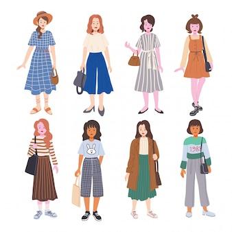 Satz der netten jungen frau gekleidet in der modischen kleidung