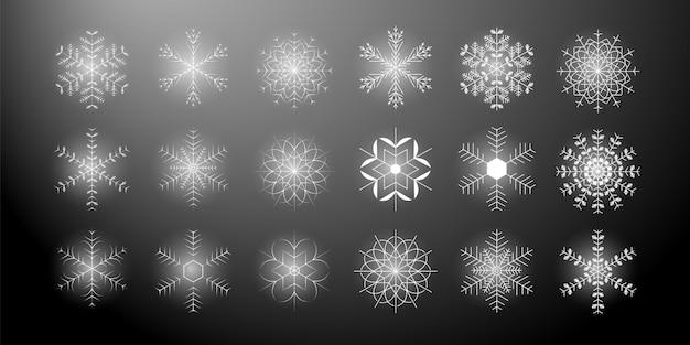 Satz der unterschiedlichen glänzenden schneeflockenikone auf einem schwarzen hintergrund. vektor-illustration eps 10.