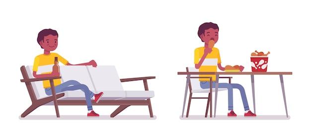Satz des jungen mannes des schwarzen oder des afroamerikaners, der isst und sich entspannt
