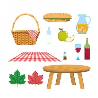 Satz des korbes mit tischdecke und der tabelle mit lebensmittel