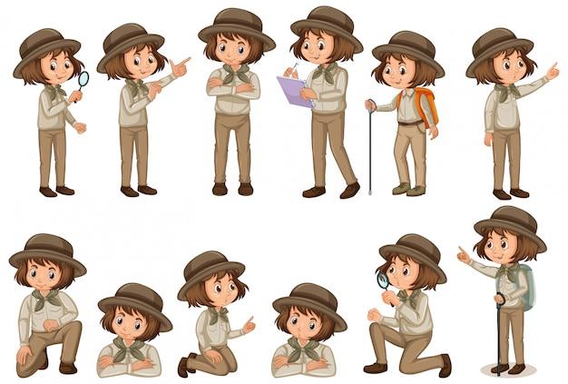 Satz des mädchens in der safariausstattung, die verschiedene haltungen tut