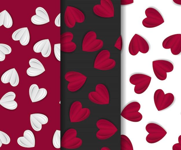 Satz des nahtlosen musters mit papierhandwerksherzen auf rot, weiß und schwarzem