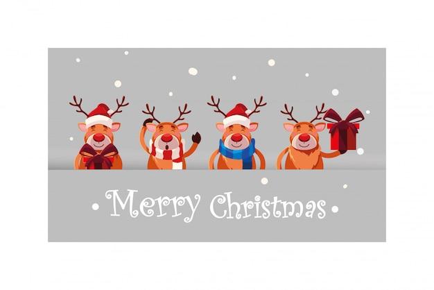 Satz des rens in der winterlandschaft mit beschriftung der frohen weihnachten