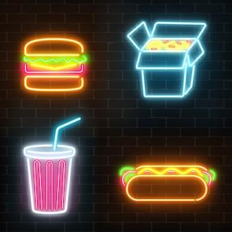 Satz fast-food-leuchtreklamen auf einem dunklen backsteinmauerhintergrund.