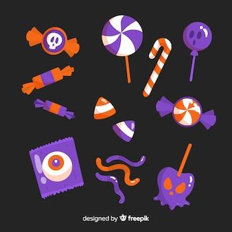 Satz flaches design der halloween-süßigkeiten