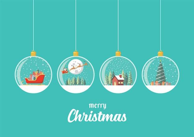 Satz frohe weihnachtsglaskugeln, die auf blauem hintergrund hängen.