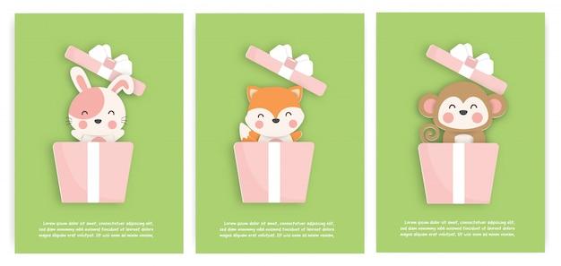 Satz geburtstagskarten mit niedlichen tieren in einer geschenkbox. papierschnitt stil.