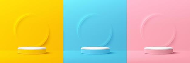 Satz gelbe blaue rosa weiße 3d-zylinderpodestpodestprägen ringform mit pastellfarbenem hintergrund