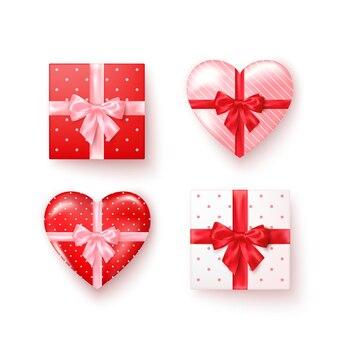 Satz geschenkboxen mit seidenschleifen in der realistischen art draufsicht. quadratische und herzförmige kästen.