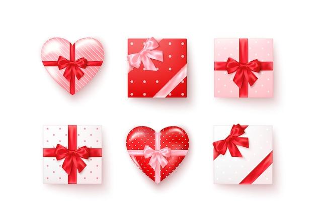 Satz geschenkboxen mit seidenschleifen in der realistischen art draufsicht.