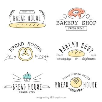 Satz gezeichnete art der bäckereilogos in der hand