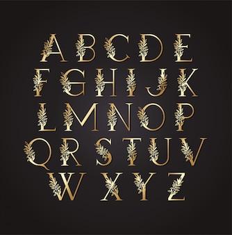 Satz goldene buchstaben mit blättern