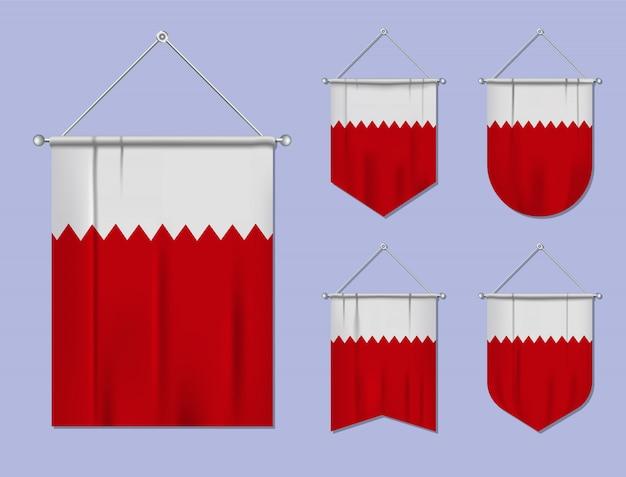 Satz hängende flaggen bahrain mit textilbeschaffenheit. diversitätsformen des nationalflaggenlandes. vertikaler schablonenwimpel