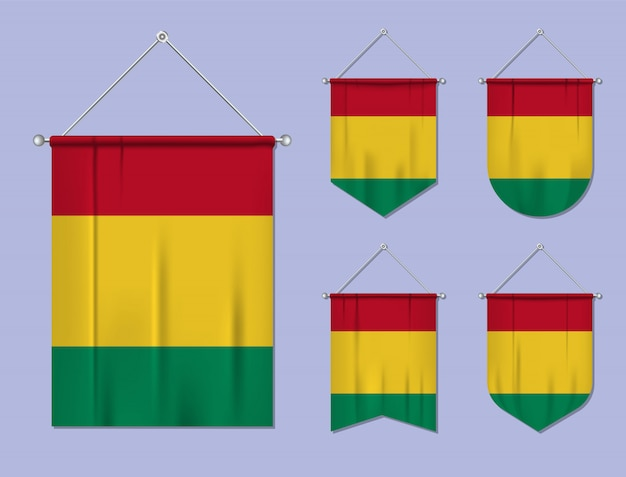Satz hängende flaggen guinea mit textilbeschaffenheit. diversitätsformen des nationalflaggenlandes. vertikaler schablonenwimpel