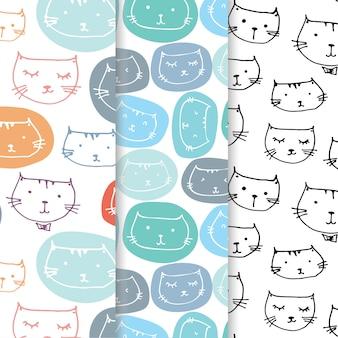 Satz hand gezeichneter netter katzen-muster-hintergrund.
