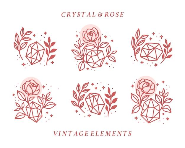 Satz handgezeichnete vintage kristall und botanische rose blumenlogoelement