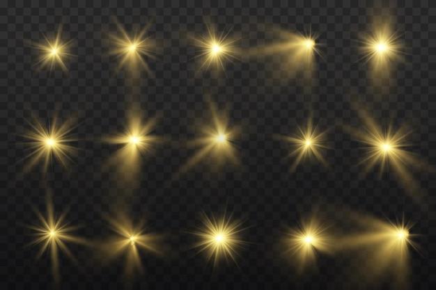 Satz heller stern. gelbes leuchtendes licht auf transparent.