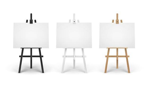 Satz hölzerne braune schwarze weiße weiße sienna staffeleien mit leeren leeren horizontalen leinwänden