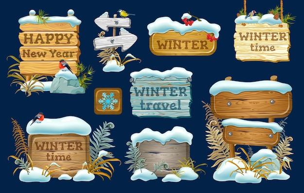 Satz holzbretter mit schneeverwehung.