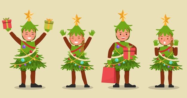 Satz kinderjungen und -mädchen, die weihnachtsbaumkostümcharakter tragen