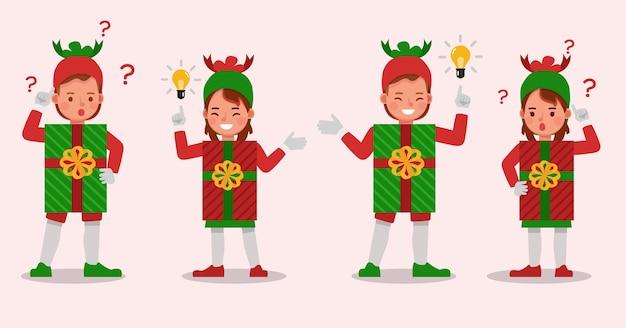 Satz kinderjungen und -mädchen, die weihnachtsgeschenkbox-kostümcharakter tragen