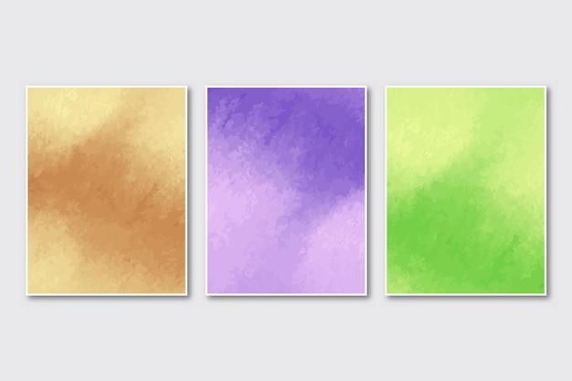 Satz kreativer minimalistischer handgemalter abstrakter aquarellhintergrund