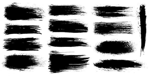 Satz künstlerische bürstenanschläge des schmutzes, bürsten. kreative gestaltungselemente. breite pinselstriche des schmutzaquarells. schwarze ansammlung getrennt auf weißem hintergrund