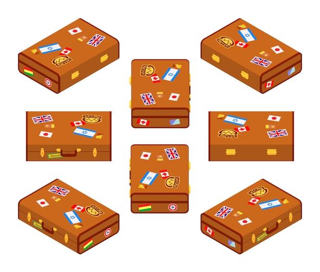 Satz liegende braune reisendkoffer mit den aufklebern