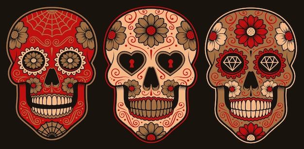 Satz mexikanische zuckerschädel auf einem dunklen hintergrund.
