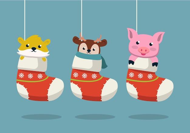 Satz niedliche tiere in socken-weihnachtsdesignillustration