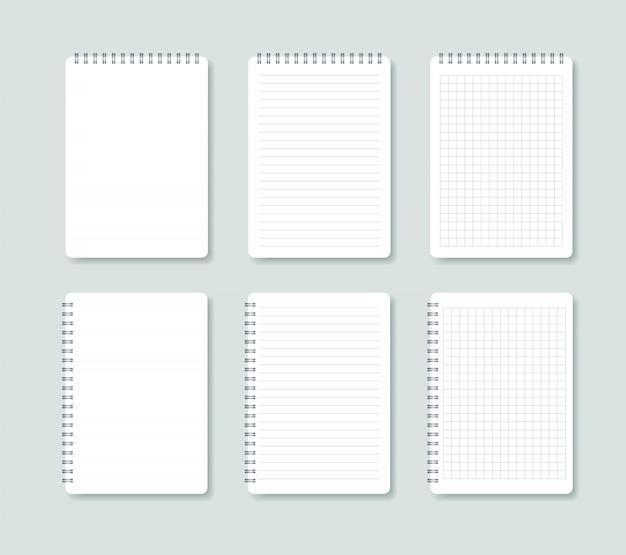Satz offener notizblock. notizbuchblätter in einer reihe und in einem käfig.