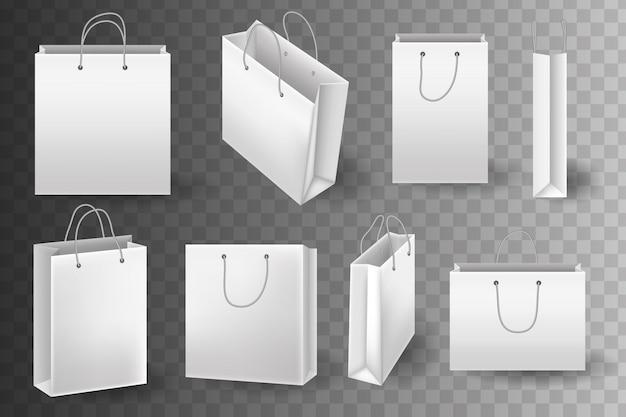 Satz papier-einkaufstütenverpackung für den einkauf von waren und produkten, die einkäufe vom geschäft oder vom lebensmittelgeschäft transportieren. unternehmensidentität leere verpackung, einkaufstasche papiermodell.