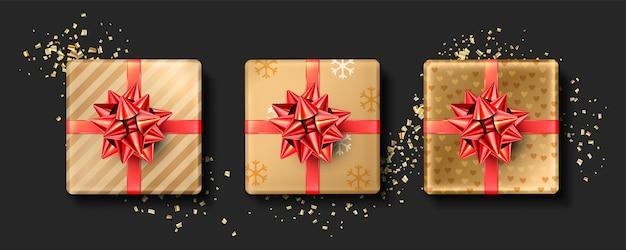 Satz realistische weihnachtsgeschenke mit folienroter schleife