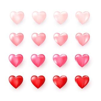 Satz rote und rosa dekorative herzen