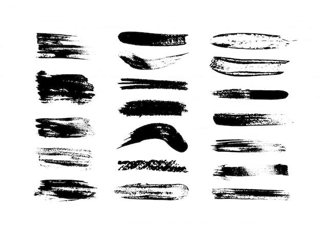 Satz schwarze farbe, striche, pinsel. dekorationselemente