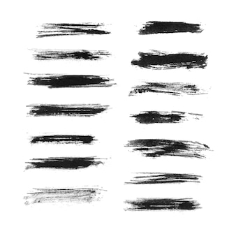 Satz schwarze schmutzpinselstriche lokalisiert auf weißem hintergrund Premium Vektoren