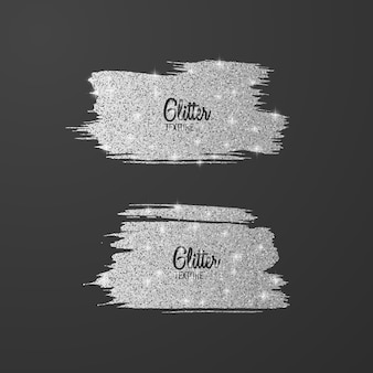 Satz silberne glitzerbürsten lokalisiert auf grau