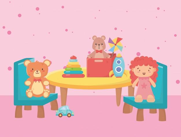 Satz spielzeug für kinder um einen kleinen tisch