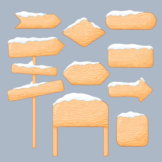 Satz verschiedene winterholzschilder und -bretter mit schnee auf ihnen. leere und zeigende pfeile